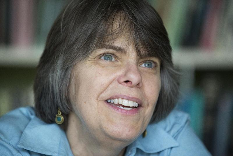 "In this photo taken Tuesday, Aug. 27, 2013, Mary Beth Tinker, 61, talk to the Associated Press during an interview at her home in Washington. Tinker was just 13 when she spoke out against the Vietnam War by wearing a black armband to her Iowa school in 1965. When the school suspended her, she took her free speech case all the way to the U.S. Supreme Court and won. Her message: Students should take action on issues important to them. ""It's better for our whole society when kids have a voice,"" she says. Tinker has quit her part-time job as a nurse and will travel the country telling her story, stopping at more than three dozen locations, most of them schools. She plans a tour of schools in western states in the spring. (AP Photo/Manuel Balce Ceneta)"