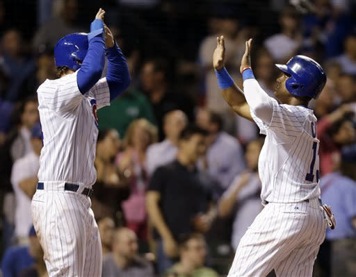 Chicago Cubs' Starlin Castro, right, celebrates with Anthony Rizzo after scoring on a two-RBI double by Dioner Navarro during the third inning of a baseball game against the San Diego Padres in Chicago, Wednesday, May 1, 2013. (AP Photo/Nam Y. Huh)