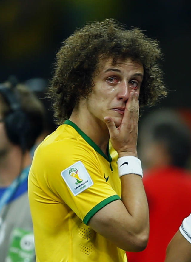Brazil's David Luiz cries after his team lost to Germany in their 2014 World Cup semi-finals at the Mineirao stadium in Belo Horizonte July 8, 2014. REUTERS/Eddie Keogh (BRAZIL - Tags: SOCCER SPORT WORLD CUP)