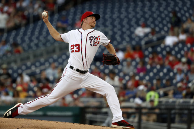 Washington Nationals pitcher Erick Fedde (23) winds up a pitch in the second inning of a baseball game against the Miami Marlins Sunday, May 26, 2019, in Washington. (AP Photo/Jacquelyn Martin)