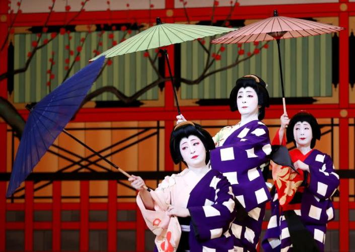 FILE PHOTO: Geishas, traditional Japanese female entertainers, perform their dance during a press preview of the annual Azuma Odori Dance Festival in Tokyo