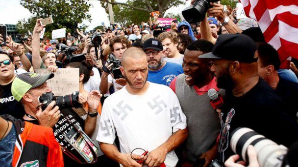 PHOTO: A man wearing a shirt with swastikas is forced away from the scene by the crowd near the site of a planned speech by white nationalist Richard Spencer at the University of Florida campus, Oct. 19, 2017, in Gainesville, Florida. (Brian Blanco/Getty Images)