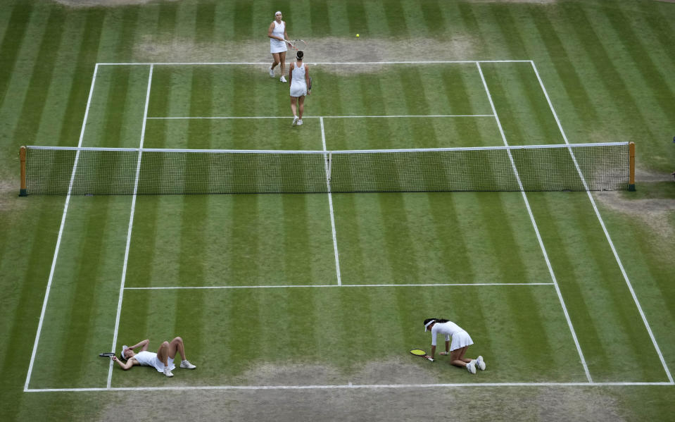 Taiwan's Su-Wei Hsieh, foreground right, and teammate Belgium's Elise Mertens react after they won the women's doubles final match against Russia's Veronika Kudermetova and Elena Vesnina on day twelve of the Wimbledon Tennis Championships in London, Saturday, July 10, 2021. (AP Photo/Alberto Pezzali)