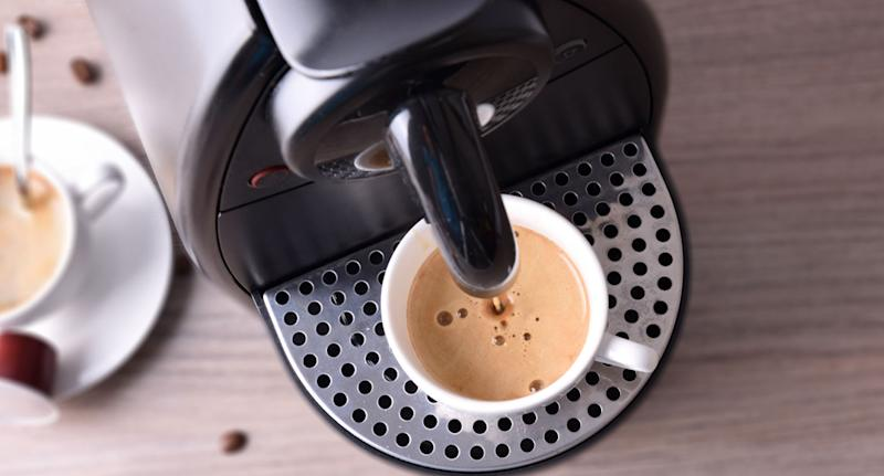Coffee machine shown as owners of the appliance are warned of how disgusting they are. Pictured is a stock image of a coffee pod machine dispensing a drink.