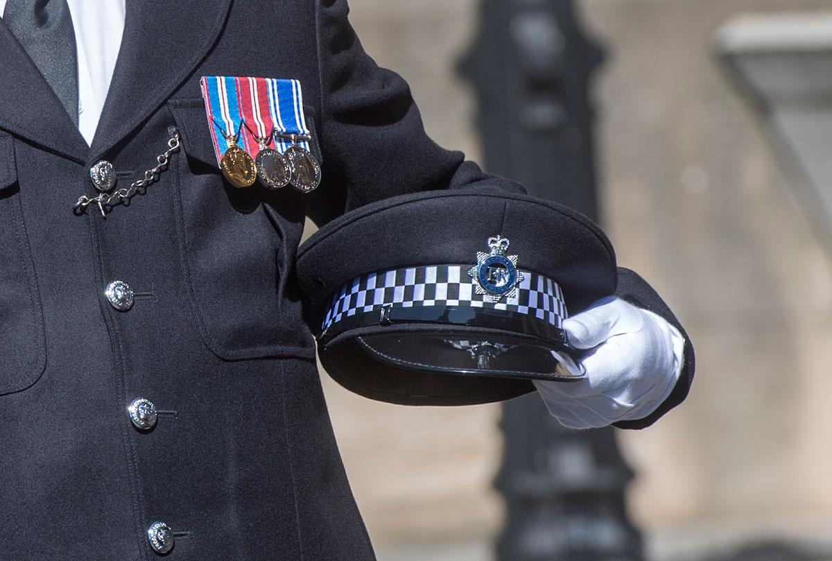 <p>PC Palmer's police cap is brought to the Palace of Westminster. (PA Images) </p>