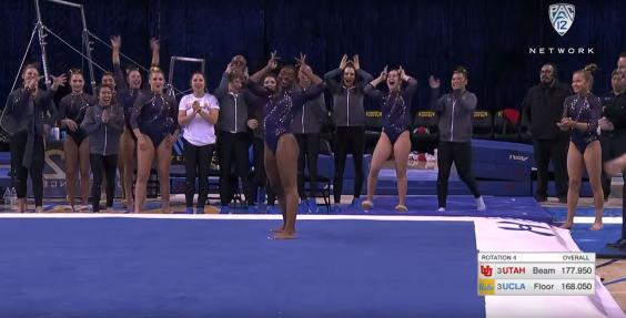 Nia Dennis places a 'crown' on her head at the end of her Beyoncé Homecoming-inspired routine (YouTube/UCLA Athletics)