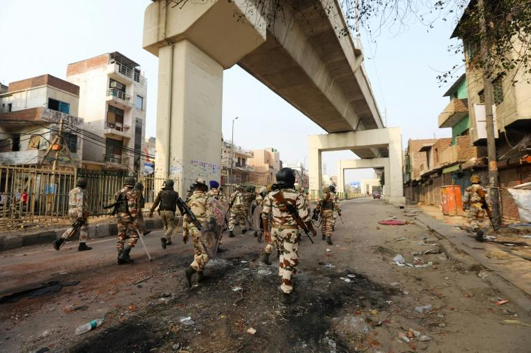 Indian security personnel patrol following clashes in the Indian capital between supporters and opponents of a new citizenship law