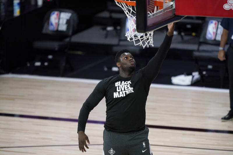 LAKE BUENA VISTA, FLORIDA - JULY 30: Zion Williamson of the New Orleans Pelicans wears a Black Lives Matter shirt as he is introduced before the start of an NBA basketball game against the Utah Jazz at HP Field House at ESPN Wide World Of Sports Complex on July 30, 2020 in Reunion, Florida. NOTE TO USER: User expressly acknowledges and agrees that, by downloading and or using this photograph, User is consenting to the terms and conditions of the Getty Images License Agreement. (Photo by Ashley Landis-Pool/Getty Images)
