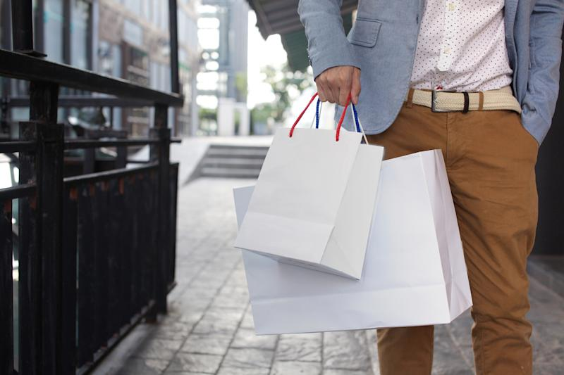 A man holding several shopping bags.