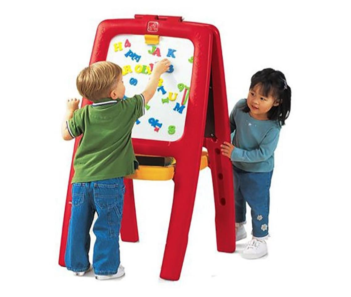 """<p><strong>Why she'll love it:</strong>Giving your kiddo a spot dedicated to getting creative lets her cultivate her inner artist (and means she won't be using the couch).</p> <p><strong>Why experts love it:</strong>""""Writing on an easel supports good wrist and hand positions—skills that are a prerequisite to healthy handwriting,"""" says Weiss.</p> <p><strong>Our pick:</strong>This double-sided easel has a roomy storage tray, a paper clip for endless doodling, and magnetic letters for all types of fun.</p> <p><a rel=""""nofollow"""" href=""""https://www.amazon.com/Step2-Easel-Magnetic-Letters-Numbers/dp/B001BSBYAU/ref=as_li_ss_tl?ie=UTF8&linkCode=ll1&tag=mparholchristmasggbestgiftsfortwoyearoldslhoct18-20&linkId=a3648c57b293a24c203517221784bacb&language=en_US"""">Shop This</a></p>"""