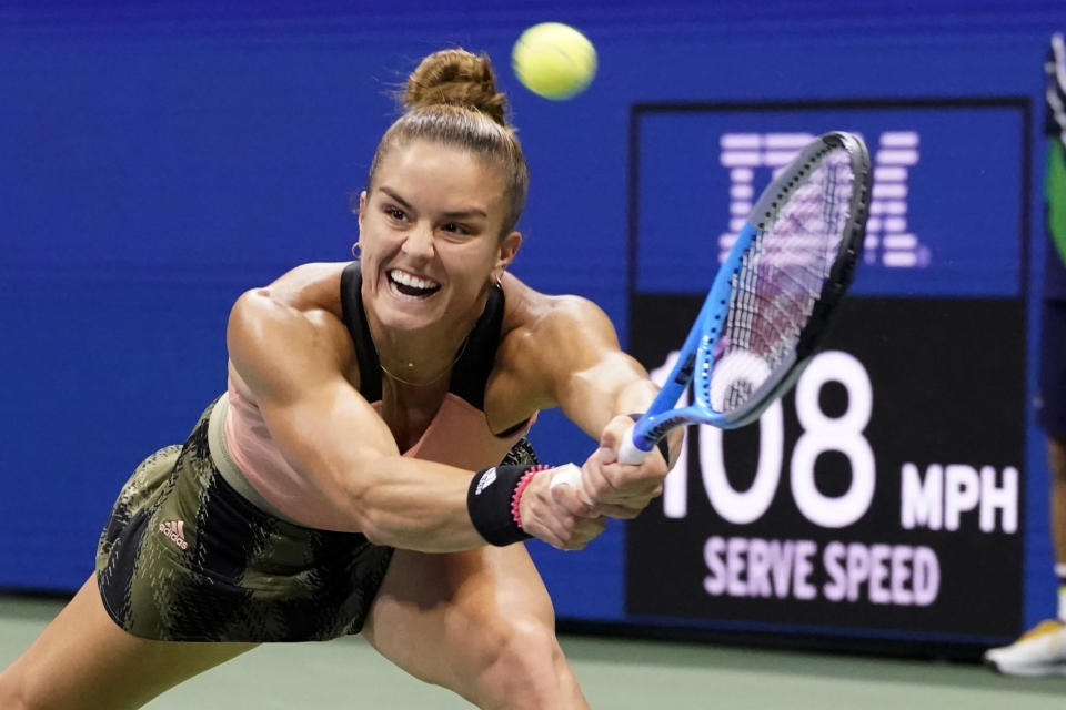 Maria Sakkari, of Greece, returns to Bianca Andreescu, of Canada, during the fourth round of the US Open tennis championships, Tuesday, Sept. 7, 2021, in New York. (AP Photo/John Minchillo)
