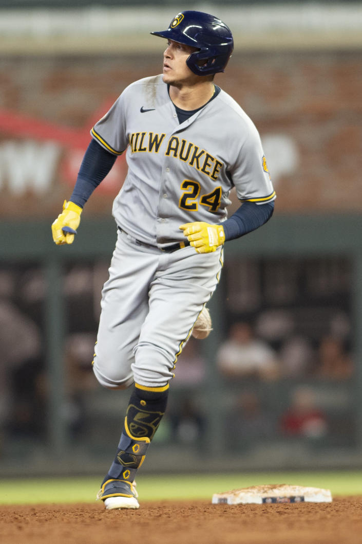 Milwaukee Brewers'' Avisail Garcia (24) rounds second base after hitting a two-run home run during the third inning of a baseball against the Atlanta Braves, Friday, July 30, 2021, in Atlanta. (AP Photo/Hakim Wright Sr.)
