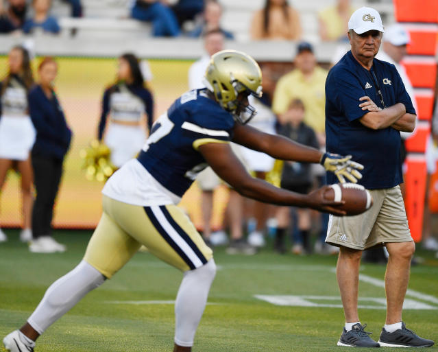 Georgia Tech's Presley Harvin III punts as coach Paul Johnson watches during the NCAA college football team's scrimmage Friday, April 20, 2018, in Atlanta. (AP Photo/Mike Stewart)