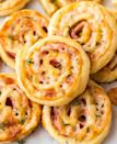 "<p>These pinwheels are super simple to make thanks to store-bought puff pastry.</p><p><strong>Get the recipe at <a href=""https://www.wellplated.com/ham-and-cheese-pinwheels/"" rel=""nofollow noopener"" target=""_blank"" data-ylk=""slk:Well Plated by Erin"" class=""link rapid-noclick-resp"">Well Plated by Erin</a>.</strong></p>"