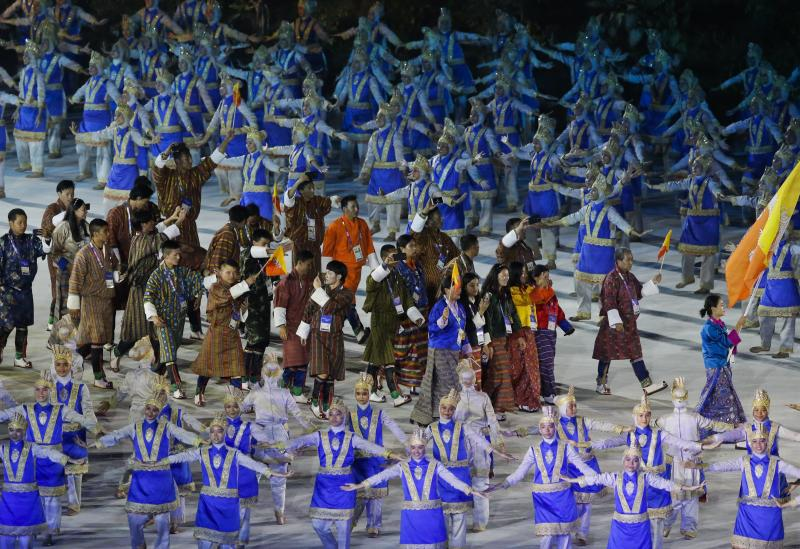 The Bhutan team marches into the Gelora Bung Karno Stadium during the opening ceremony for the 18th Asian Games , Jakarta, Indonesia, Saturday, Aug. 18, 2018. (AP Photo/Firdia Lisnawati)