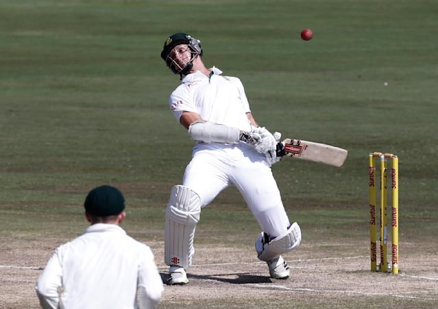 South Africa's Ryan McLaren ducks a bouncer during the fourth day of their first cricket test match against Australia in Pretoria, February 15, 2014. REUTERS/Mike Hutchings (SOUTH AFRICA - Tags: SPORT CRICKET)