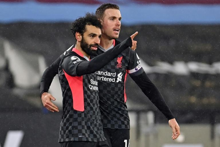 Liverpool's Mohamed Salah (L) celebrates with Jordan Henderson