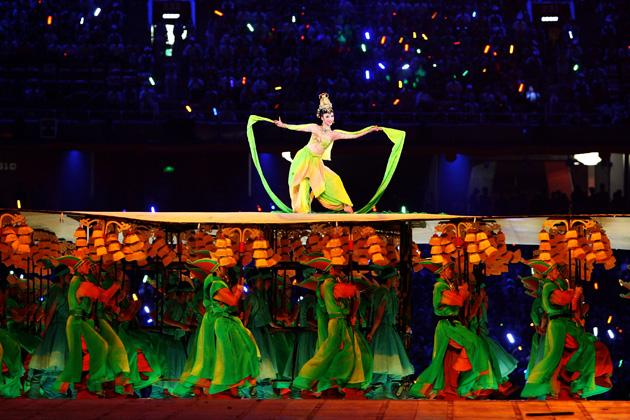 BEIJING - AUGUST 08:  A Chinese lady performs during the Opening Ceremony for the 2008 Beijing Summer Olympics at the National Stadium on August 8, 2008 in Beijing, China.  (Photo by Paul Gilham/Getty Images)