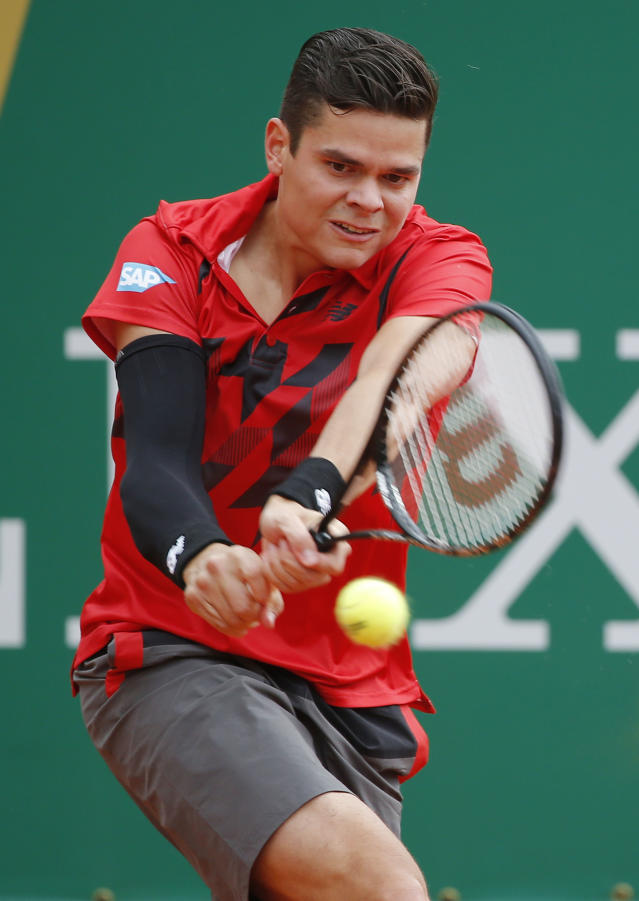 Milos Raonic of Canada returns the ball to Yen-Hsun Lu of Taiwan during their match of the Monte Carlo Tennis Masters tournament in Monaco, Wednesday, April 16, 2014. (AP Photo/Michel Euler)