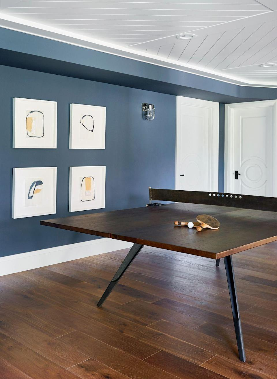 "<p>Investing in a stylish ping-pong table will ensure that everyone has fun but it also blends into the space and looks upscale. In this room designed by <a href=""https://stylebyemilyhenderson.com/"" rel=""nofollow noopener"" target=""_blank"" data-ylk=""slk:Emily Henderson"" class=""link rapid-noclick-resp"">Emily Henderson</a>, the pin pong table reflects the dark hardwood floors. Just make sure no one ruins it with a game of beer pong (adults-only, of course). </p>"