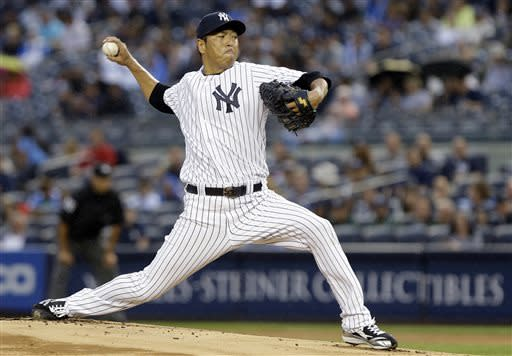 New York Yankees' Hiroki Kuroda, of Japan, delivers a pitch during the first inning of a baseball game against the Minnesota Twins on Friday, July 12, 2013, in New York. (AP Photo/Frank Franklin II)