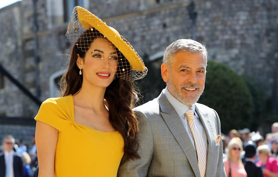 Amal and George Clooney arrive at the royal wedding (Picture: PA)