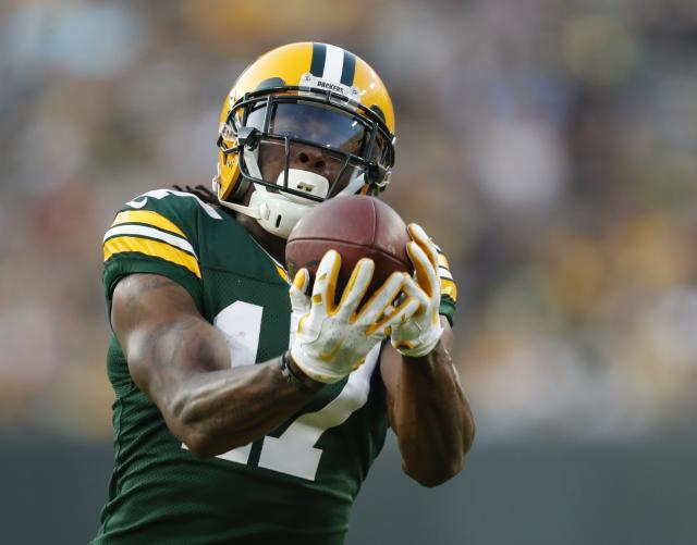 "<a class=""link rapid-noclick-resp"" href=""/nfl/players/27581/"" data-ylk=""slk:Davante Adams"">Davante Adams</a> is kind enough to wear his (rough) ADP on his uniform (AP Photo/Matt Ludtke)"