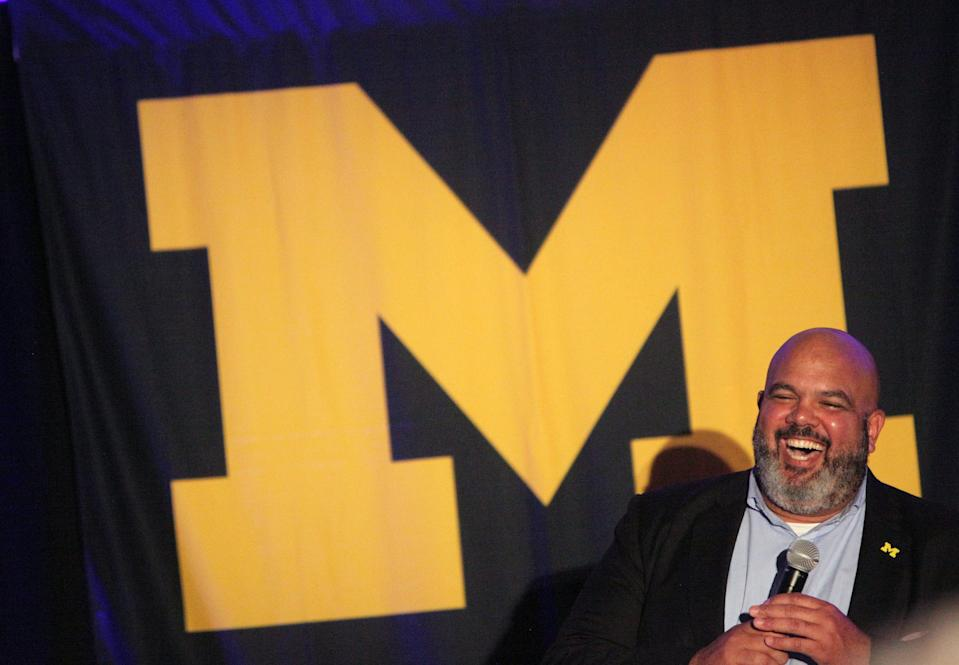 Michigan athletic director Warde Manuel smiles during a pep rally at San Antonio Marriott Riverwalk for the Final Four in San Antonio, Texas, Friday, March 30, 2018.