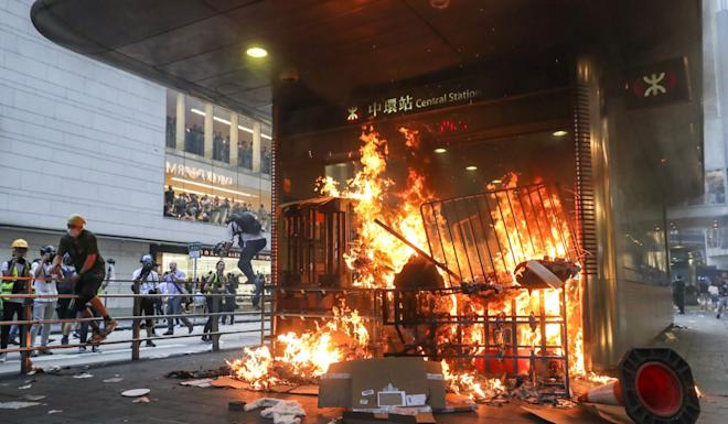 Protesters start a fire at a Central MTR station entrance on Pedder Street in Central on Sunday. Photo: Edmond So