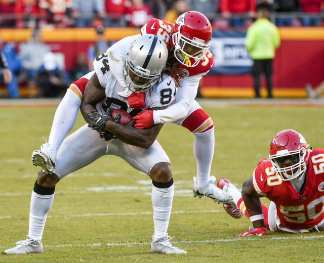 <p>Kansas City Chiefs defensive back Terrance Mitchell (39) tackles Oakland Raiders wide receiver Cordarrelle Patterson (84) as linebacker Justin Houston (50) watches during the second half of an NFL football game in Kansas City, Mo., Sunday, Dec. 10, 2017. (AP Photo/Ed Zurga) </p>