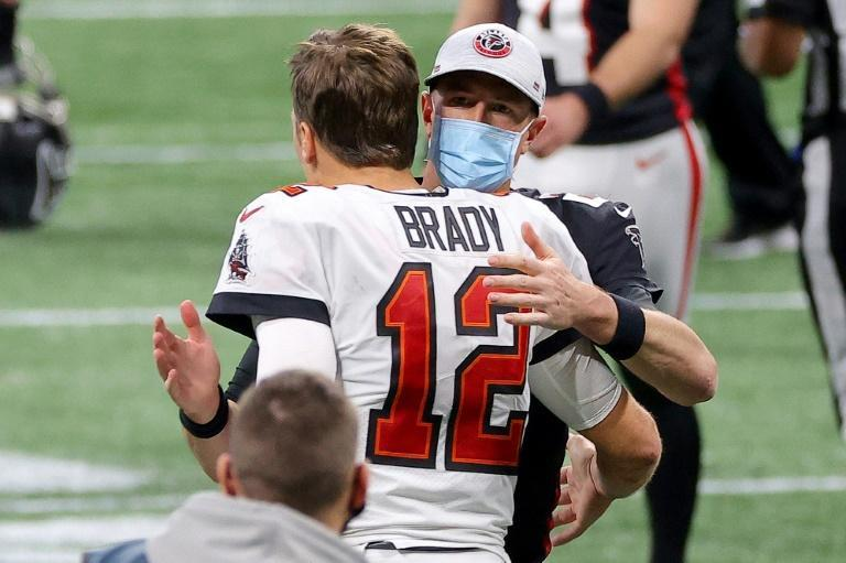 Atlanta Falcons quarterback Matt Ryan congratulates Tampa Bay counterpart Tom Brady after the Buccaneers rallied for an NFL victory