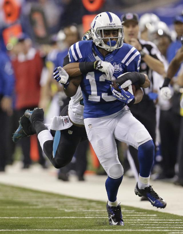 Indianapolis Colts' T.Y. Hilton (13) is tackled by Jacksonville Jaguars' Josh Evans during the second half of an NFL football game on Sunday, Dec. 29, 2013, in Indianapolis. (AP Photo/AJ Mast)