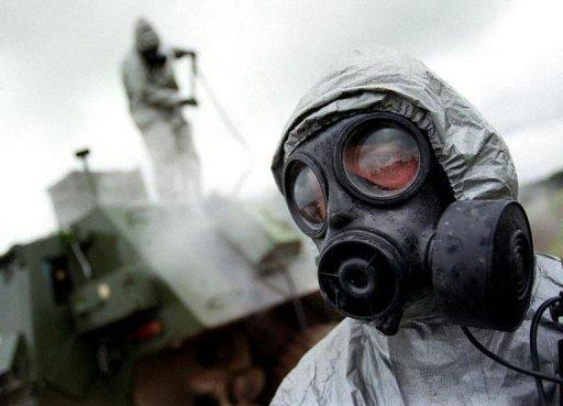 A soldier wears an NBC (nuclear, biological and chemical) warfare suit during an anti-terror exercise. Syria will never use chemical weapons against its own people, state television has quoted a foreign ministry official as saying