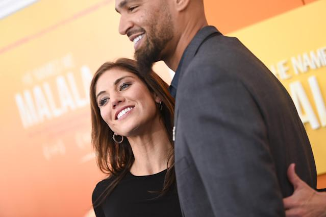Hope Solo and husband Jerramy Stevens are expecting twins. (Photo by Evan Agostini/Invision/AP)