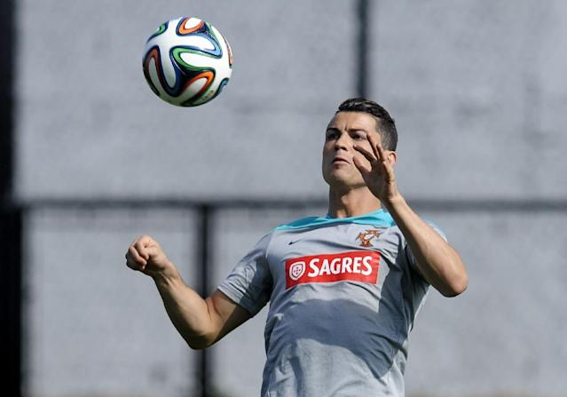 Cristiano Ronaldo controls the ball during a training session of Portugal in Campinas, Brazil, Thursday, June 19, 2014. Portugal plays in group G of the Brazil 2014 soccer World Cup. (AP Photo/Paulo Duarte)