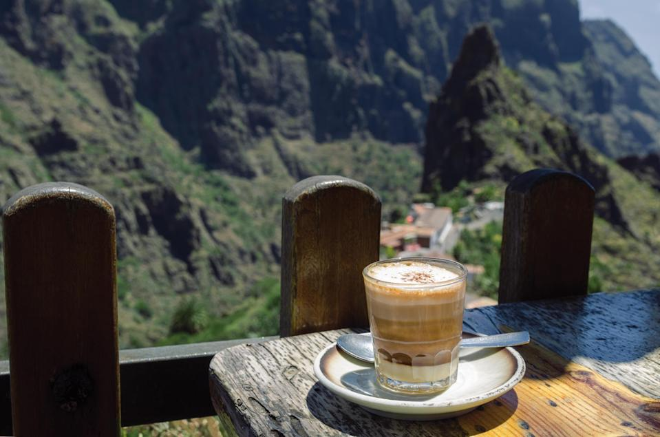 """<p>On Tenerife, one of the Canary Islands, the coffee drink Barraquito takes on a full spectrum of flavors. Rich espresso is countered by bright lemon peel; alkalic, thick condensed milk; spicy cinnamon, and warm Licor 43. The ingredients layer on top of each other in a clear glass, forming an ombre in shades of brown resembling a parfait, often served as dessert. </p> <p><strong>Try it at home:</strong> <a href=""""https://fave.co/2XAmixL"""" rel=""""nofollow noopener"""" target=""""_blank"""" data-ylk=""""slk:$22 licor 43 at totalwine.com"""" class=""""link rapid-noclick-resp"""">$22 licor 43 at totalwine.com</a></p>"""