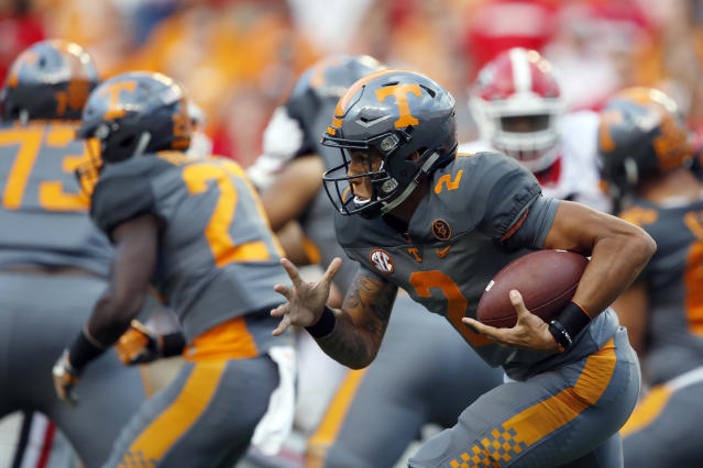 "Tennessee quarterback <a class=""link rapid-noclick-resp"" href=""/ncaaf/players/266814/"" data-ylk=""slk:Jarrett Guarantano"">Jarrett Guarantano</a> (2) runs for yardage in the second half of an NCAA college football game against Georgia Saturday, Sept. 30, 2017, in Knoxville, Tenn. Georgia won 41-0. (AP Photo/Wade Payne)"
