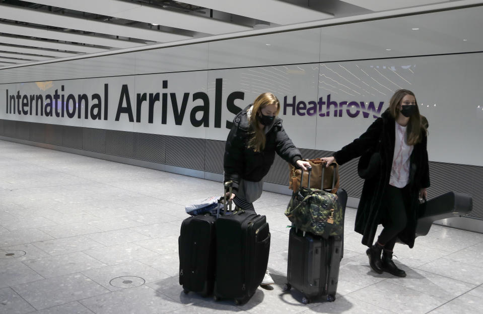 FILE - In this Jan. 17, 2021 file photo travelers arrive at Heathrow Airport in London. Britain is the fifth country in the world to record 100,000 virus-related deaths, after the United States, Brazil, India and Mexico, and by far the smallest. The U.S. has recorded more than 400,000 COVID-19 deaths, the world's highest total, but its population of about 330 million is about five times Britain's. (AP Photo/Frank Augstein, File)