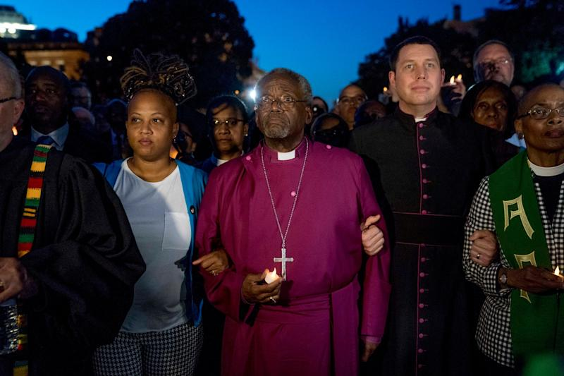 Rev Curry led a candlelight vigil outside the White House: AP