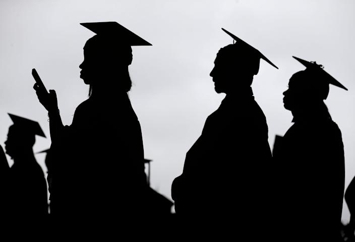 Graduates line up before the Bergen Community College commencement at MetLife Stadium in East Rutherford, N.J., on May 17, 2018.