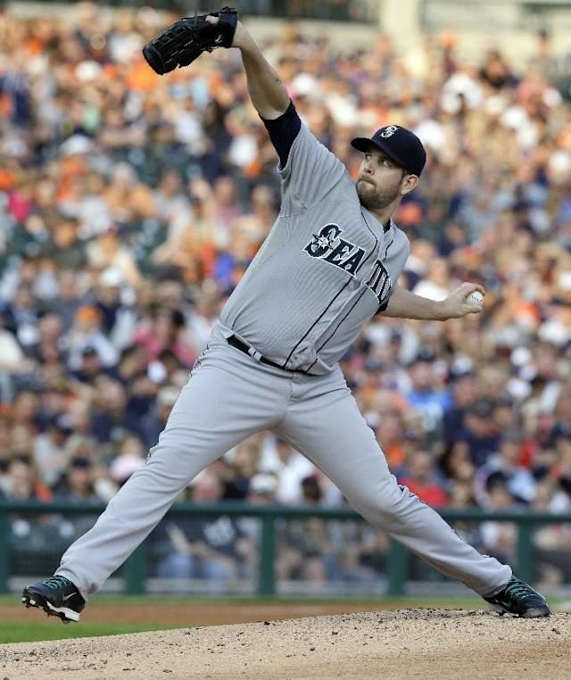 Seattle Mariners starting pitcher James Paxton throws during the first inning of a baseball game against the Detroit Tigers, Friday, Aug. 15, 2014, in Detroit. (AP Photo/Carlos Osorio)