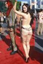"""<p>Rose McGowan arrived at the 1998 MTV Video Music Awards (home of <a href=""""https://www.cosmopolitan.com/uk/fashion/celebrity/g4122/vmas-outrageous-outfits-ever-red-carpet-photos/"""" rel=""""nofollow noopener"""" target=""""_blank"""" data-ylk=""""slk:bold naked dresses"""" class=""""link rapid-noclick-resp"""">bold naked dresses</a>) wearing this barely-there dress with beaded strings across the back.</p>"""