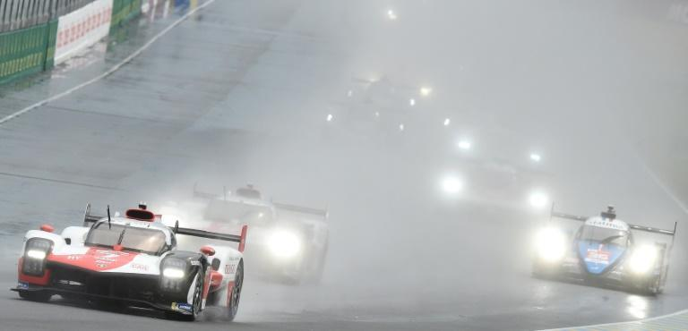 Mike Conway leads for Toyota with the spray flying at the start of the 89th Le Mans 24 Hours