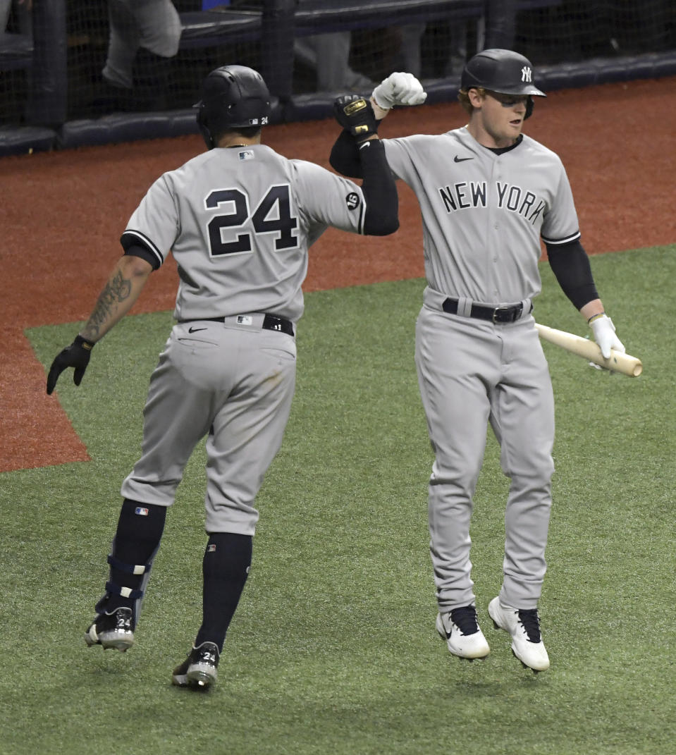 New York Yankees' Clint Frazier, right, celebrates with Gary Sanchez (24) after Sanchez hit a solo home run off Tampa Bay Rays reliever Josh Fleming during the seventh inning of a baseball game Tuesday, May 11, 2021, in St. Petersburg, Fla. (AP Photo/Steve Nesius)