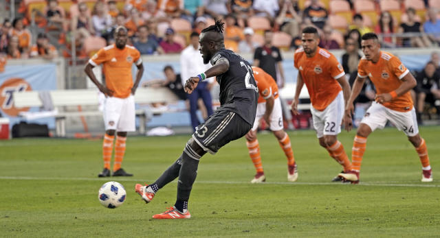 Vancouver Whitecaps's Kei Kamara (23) scores on a penalty kick against the Houston Dynamo during the first half of an MLS soccer game Saturday, March 10, 2018, in Houston. (AP Photo/David J. Phillip)