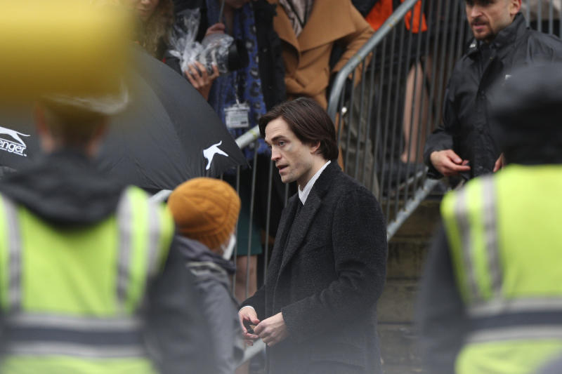 Actor Robert Pattinson during filming of The Batman outside St George's Hall in Liverpool, England, Monday Oct. 12, 2020. (Peter Byrne/PA via AP)