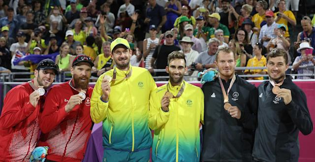 Beach Volleyball - Gold Coast 2018 Commonwealth Games - Men's Medal Ceremony - Coolangatta Beachfront - Gold Coast, Australia - April 12, 2018. Gold medalists Christopher McHugh and Damien Schumann of Australia, silver medalists Samuel Pedlow and Sam Schachter of Canada and bronze medalists Ben O'Dea and Sam O'Dea of New Zealand on the podium. REUTERS/Athit Perawongmetha