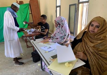 A man attends voting at a polling station during presidential election in Nouakchott
