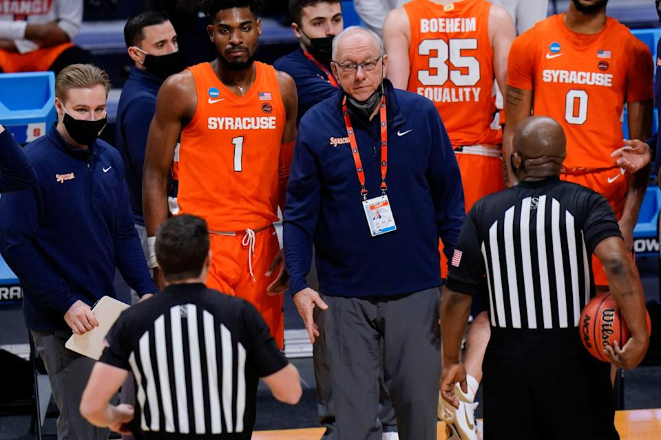 Syracuse coach Jim Boeheim talks with the officials during his team's game against San Diego State in the first round of the NCAA men's tournament at Hinkle Fieldhouse in Indianapolis, Friday, March 19, 2021.