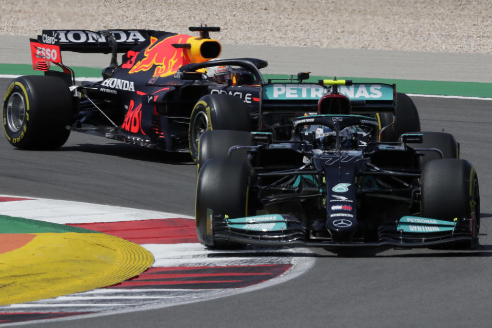 Mercedes driver Valtteri Bottas of Finland takes a curve followed by Red Bull driver Max Verstappen of the Netherlands during the Portugal Formula One Grand Prix at the Algarve International Circuit near Portimao, Portugal, Sunday, May 2, 2021. (AP Photo/Manu Fernandez)